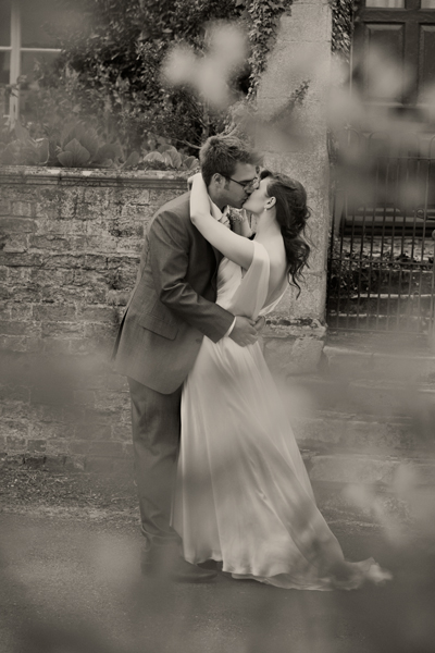 Bride and groom kissing - A Homemade Marquee Wedding