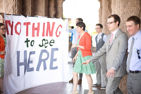 Wedding guests with Nothing to see here banner - A Fun, Fun, Fun Wedding