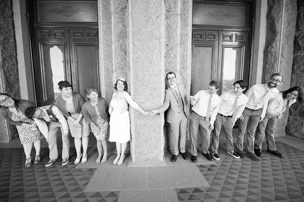 Bride and groom holding hands with bridal party by their side - A Fun, Fun, Fun Wedding