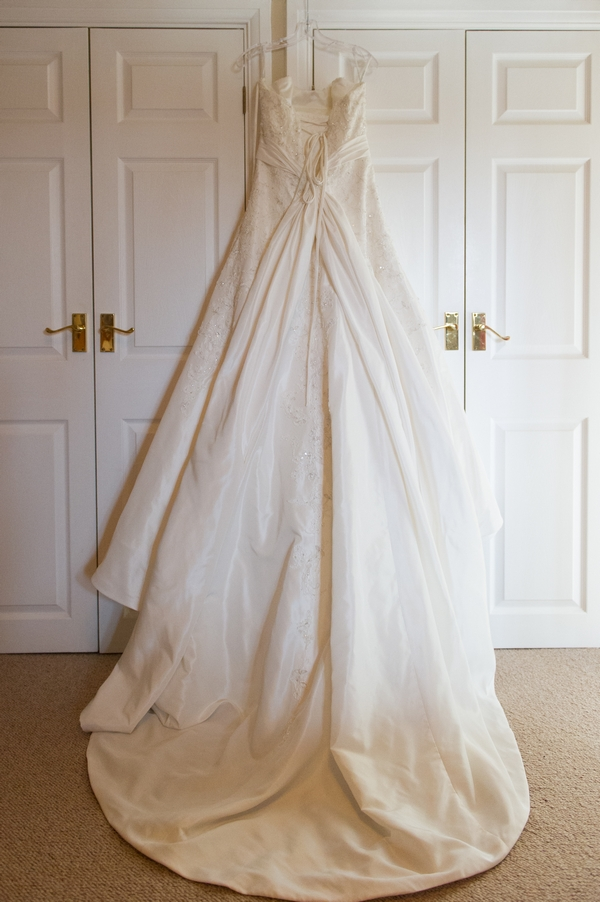 Wedding dress hanging over wardrobe - Picture by Gareth Squance Photography