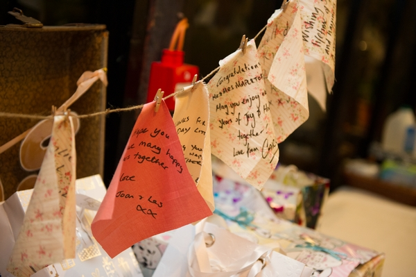 Fabric square messages hanging on washing line - Picture by Gareth Squance Photography