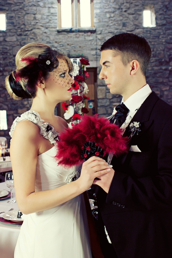 Bride and groom and red bridal bouquet - Gothic Wedding Photo Shoot at Browsholme Hall