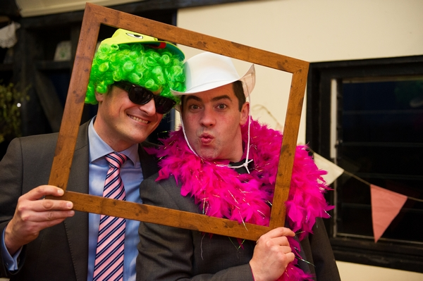 Wedding guests playing with dressing up props - Picture by Gareth Squance Photography