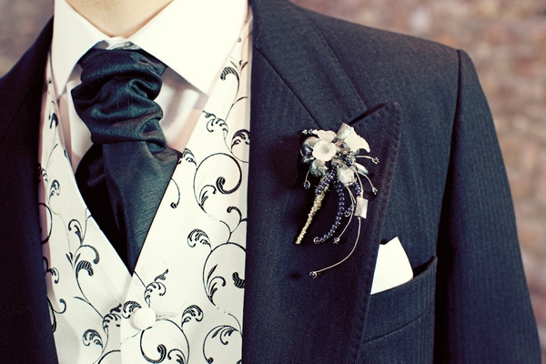 Crystal buttonhole, black cravat and black and white waistcoat - Gothic Wedding Photo Shoot at Browsholme Hall