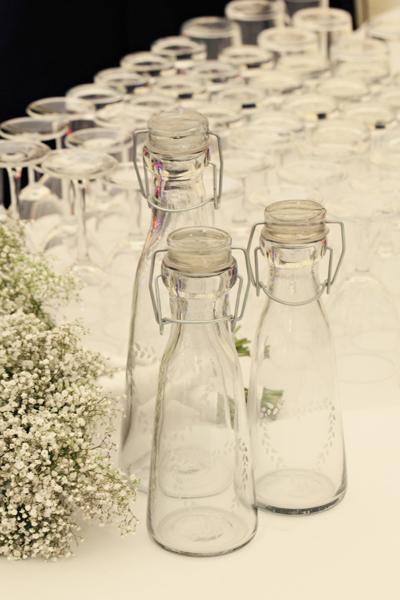 Empty glass bottles - A Homemade Marquee Wedding