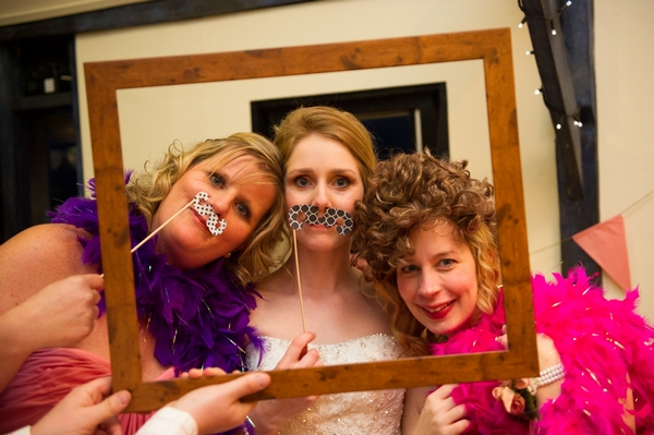 Bride and bridesmaids posing with props - Picture by Gareth Squance Photography