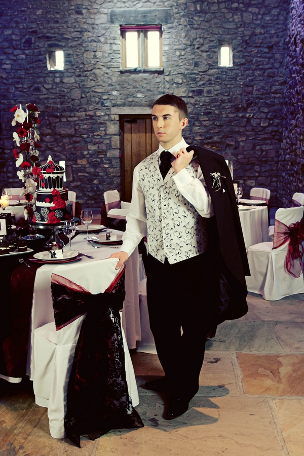 Grom with jacket on shoulder - Gothic Wedding Photo Shoot at Browsholme Hall
