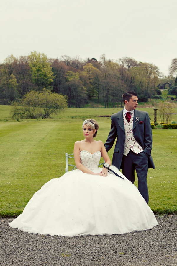 Bride and groom looking away from each other - Gothic Wedding Photo Shoot at Browsholme Hall