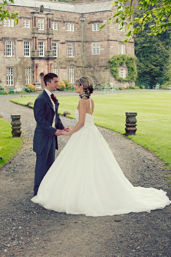 Bride and groom facing each other holding hands - Gothic Wedding Photo Shoot at Browsholme Hall