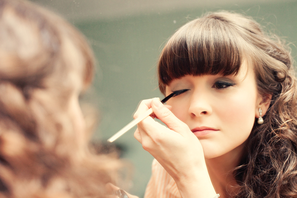 Bride applying eyeliner - A Homemade Marquee Wedding