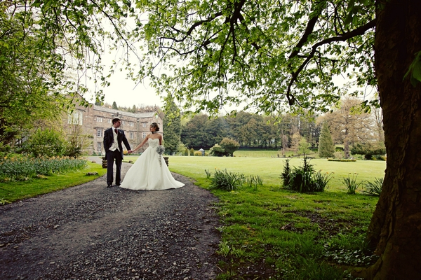 Bride and groom walking down driveway of Browsholme Hall - Gothic Wedding Photo Shoot at Browsholme Hall