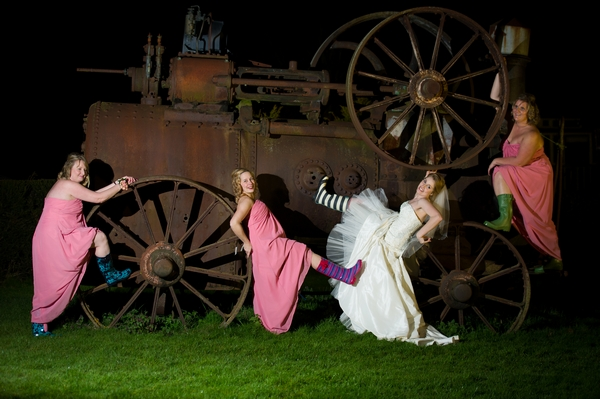 Bride and bridesmaids posing on olf farm machine - Picture by Gareth Squance Photography