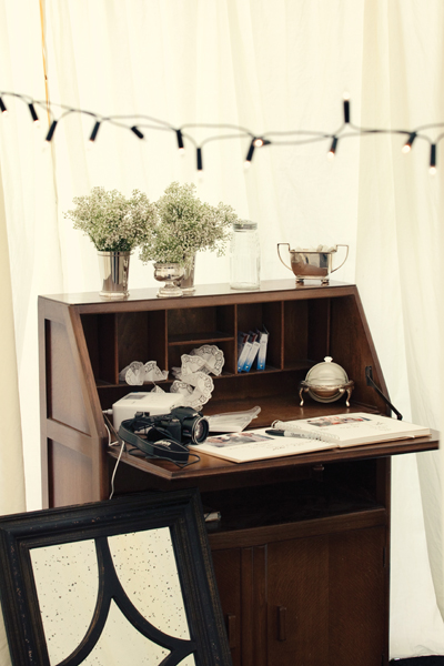 Wedding photo guest book on vintage desk - A Homemade Marquee Wedding