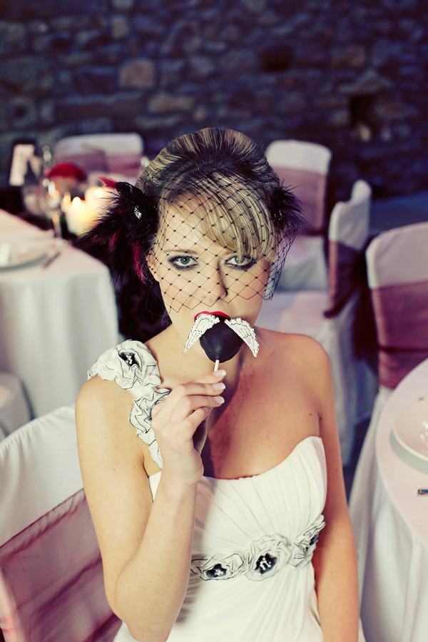 Bride eating cake pop - Gothic Wedding Photo Shoot at Browsholme Hall