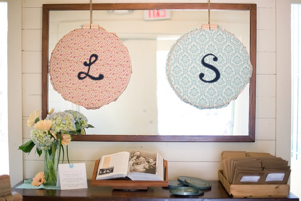 L and S signs over wedding guest book - A Fun, Fun, Fun Wedding