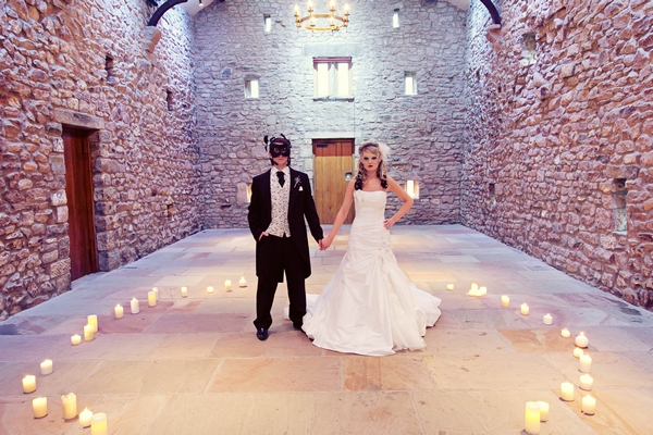 Bride and groom standing in ring of candles - Gothic Wedding Photo Shoot at Browsholme Hall
