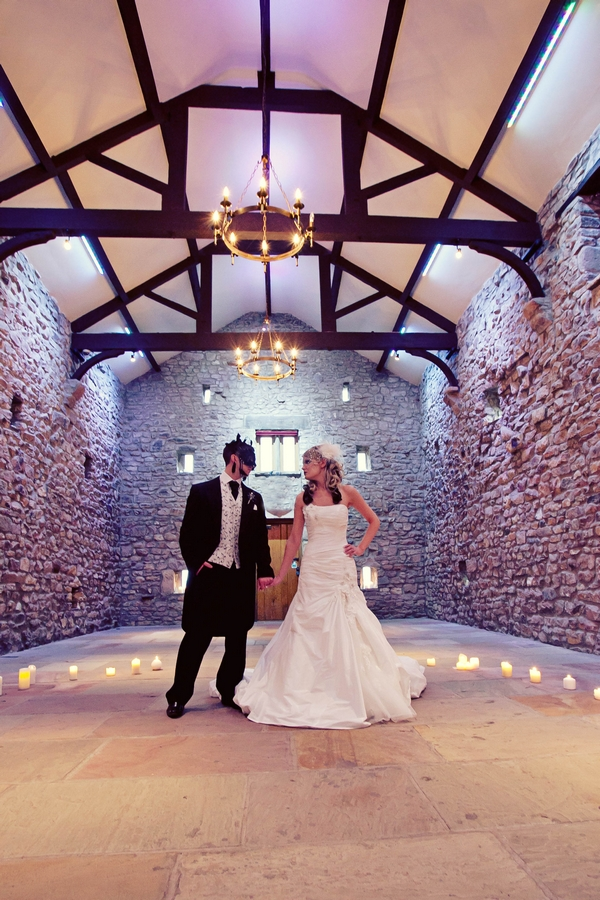 Bride and groom in barn looking at each other - Gothic Wedding Photo Shoot at Browsholme Hall