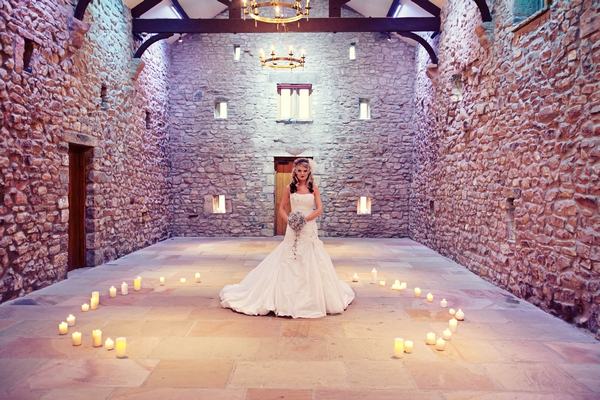 Bride holding crystal brooch bouquet standing in circle of candles - Gothic Wedding Photo Shoot at Browsholme Hall