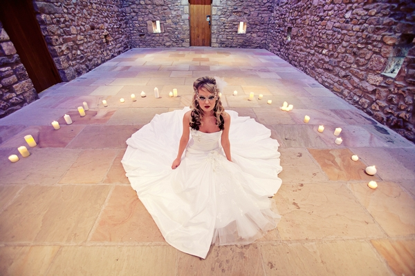 Bride sitting in circle of candles - Gothic Wedding Photo Shoot at Browsholme Hall