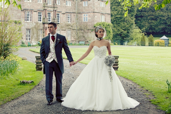 Bride and groom walking hand in hand at Browsholme Hall - Gothic Wedding Photo Shoot at Browsholme Hall