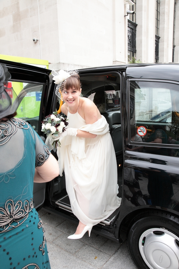 Bride getting out of London black cab - Picture by Rebecca Prigmore Photography