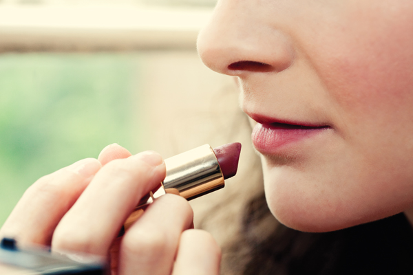 Bride applying lipstick - A Homemade Marquee Wedding