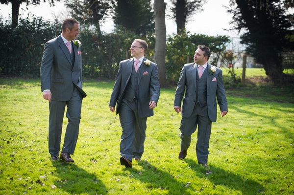 Groomsmen walking across grass - Picture by Gareth Squance Photography
