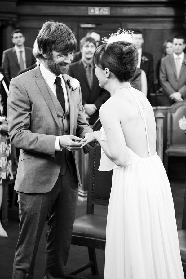 Groom placing ring on bride's finger - Picture by Rebecca Prigmore Photography