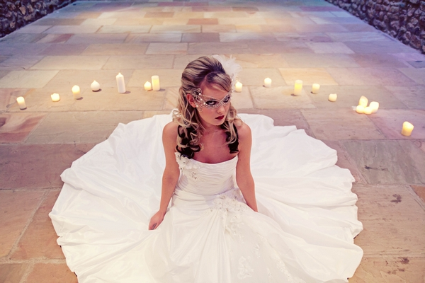 Bride sitting surrounded by candles - Gothic Wedding Photo Shoot at Browsholme Hall
