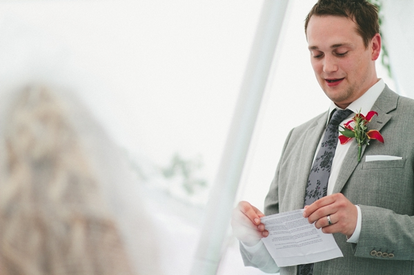 Man looking down at his wedding speech - Picture by McKinley Rodgers Photography