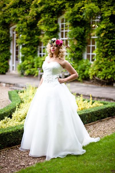 Model wearing wedding dress in garden of Goldney Hall - LoveLuxe Launch
