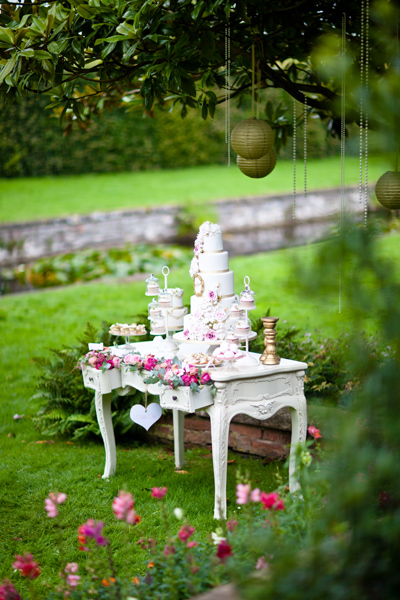 Tiered white wedding cake on white table - LoveLuxe Launch