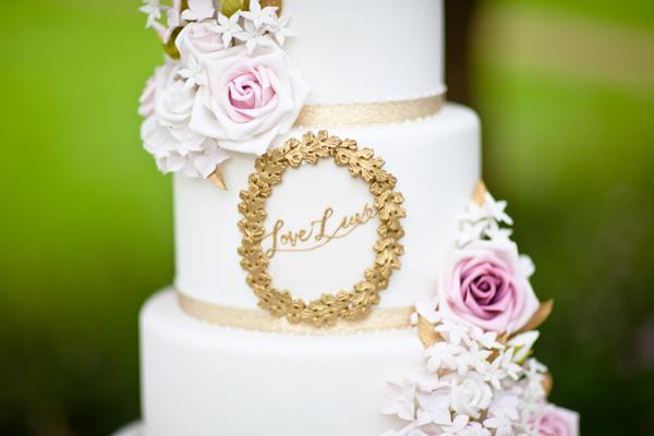 Close up of LoveLuxe written on wedding cake - LoveLuxe Launch