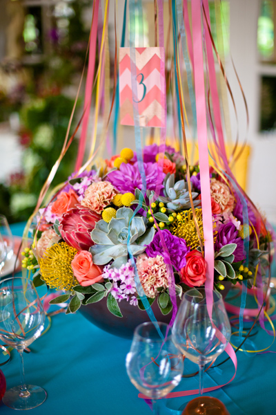 Brightly coloured wedding table flowers - LoveLuxe Launch