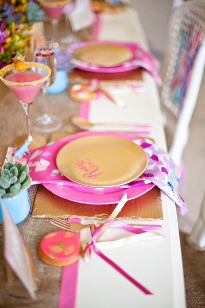 Gold plates on pink mats - LoveLuxe Launch