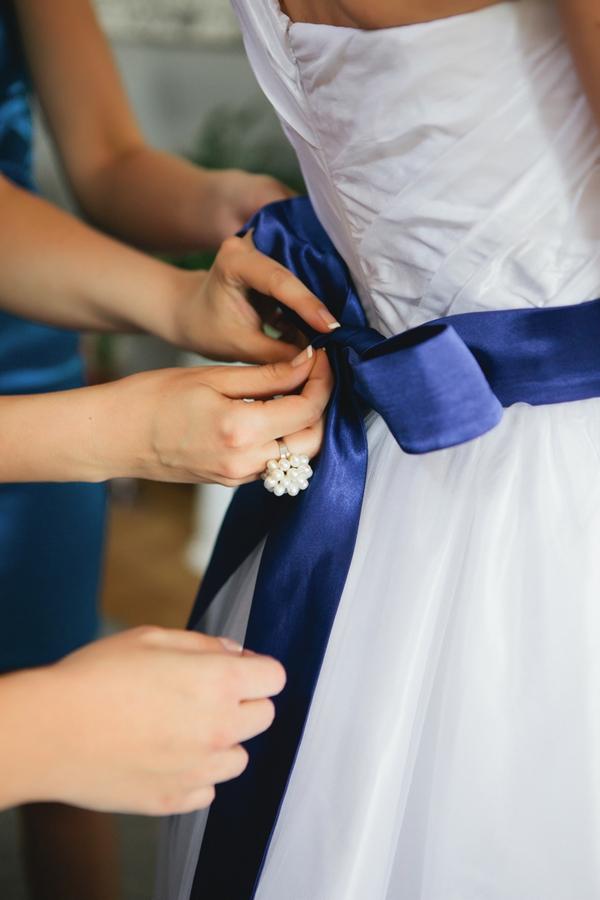 Blue ribbon on wedding dress - A Spring Themed Wedding in Hungary