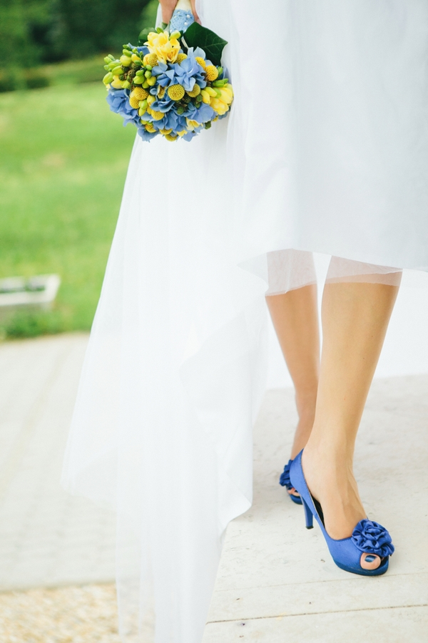 Bride's legs wearing blue shoes - A Spring Themed Wedding in Hungary