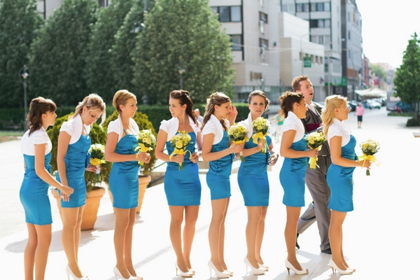 Row of bridesmaids in blue dresses - A Spring Themed Wedding in Hungary