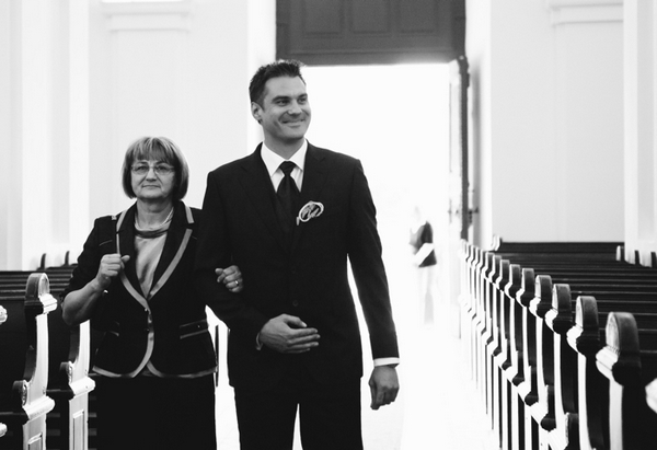 Groom walking into church with mother - A Spring Themed Wedding in Hungary