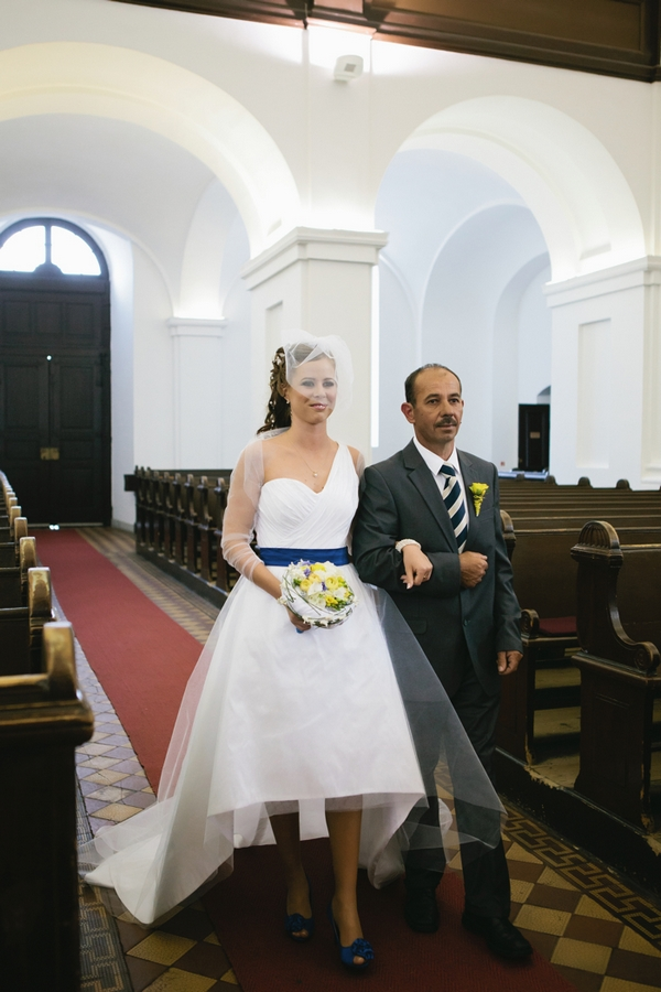 Bride and father walk into church - A Spring Themed Wedding in Hungary