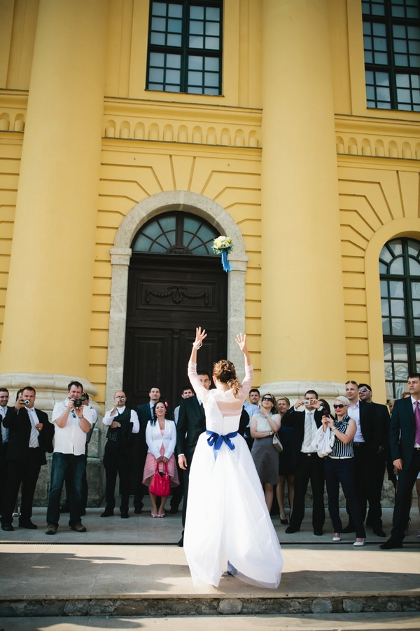 Bride throwing bouquet - A Spring Themed Wedding in Hungary