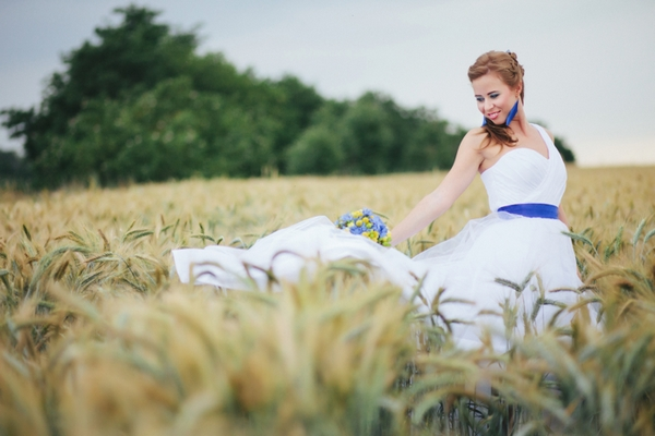 Bride in corn field - A Spring Themed Wedding in Hungary