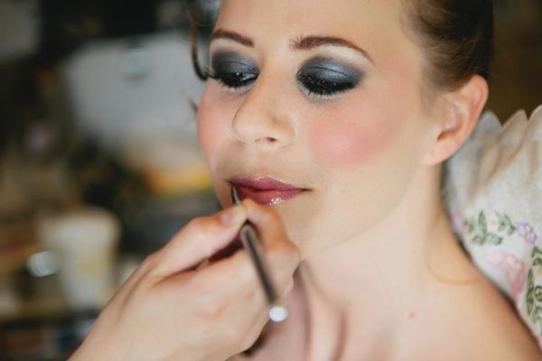 Bride applying lip gloss - A Spring Themed Wedding in Hungary