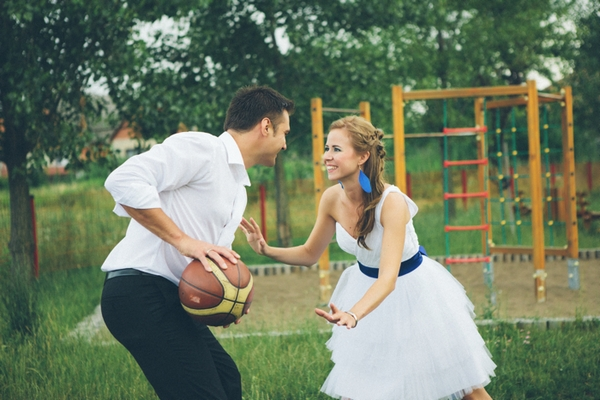 Bride and groom playing basketball - A Spring Themed Wedding in Hungary
