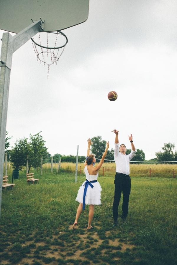 Groom shooting basketball - A Spring Themed Wedding in Hungary