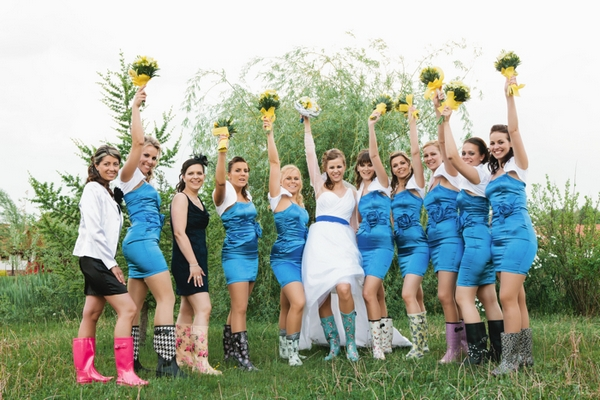 Bride and bridesmaids holding up bouquets - A Spring Themed Wedding in Hungary