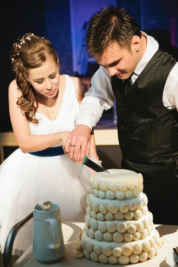 Bride and groom cutting cake - A Spring Themed Wedding in Hungary