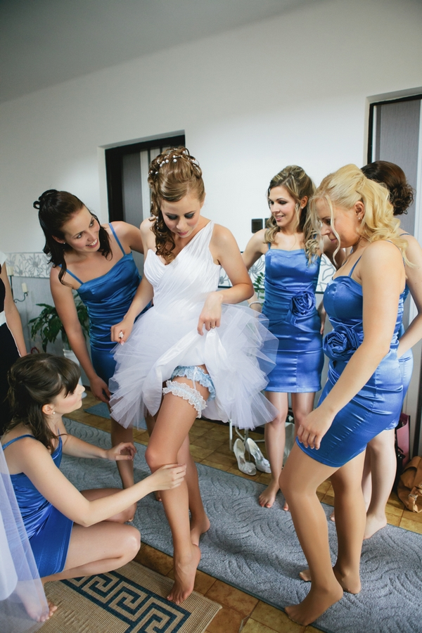 Bride showing garter - A Spring Themed Wedding in Hungary