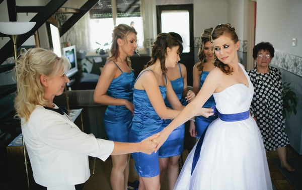 Bride wearing dress with blue ribbon - A Spring Themed Wedding in Hungary