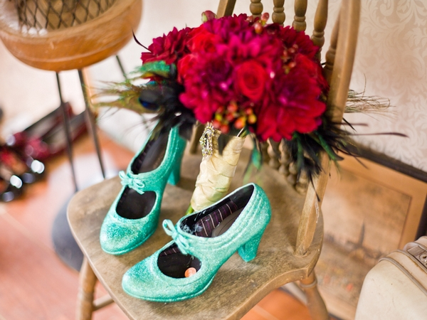Light green wedding shoes and a red bouquet